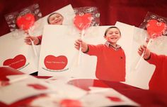 Valentines Day card idea cute kids photography Just take a picture of your child holding a fist out.  Print 4x6 pictures  ($4 at Costco for 20) Then use an exact knife and cut two slits, one on top one on bottom of the fist.  Insert heart sucker and your done!