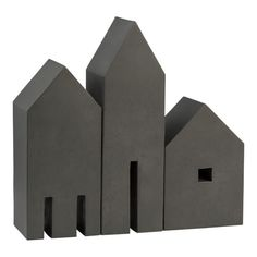 Geometric shapes in antiqued iron create a decorative architectural village with a modern edge.