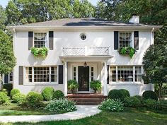 Classic Decorating You'll Love Forever : Decorating : Home & Garden Television - LOVE all the green and white, house color, simplicity, boxwoods!