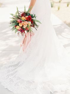 Red and yellow wedding bouquet | Photography: Kelsea Holder