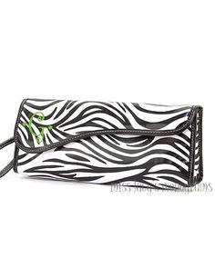 (http://misslucysmonograms.com/black-and-white-zebra-laminated-flat-iron-curling-iron-insulated-bag/)