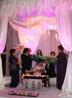 Afghan wedding. This is when the bride and groom read a page of the Quran together under a green shawl. Another thing that happens under the green shawl is that they are given a hand mirror and look at one another in it. symbolic of a first glance I believe.