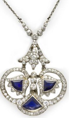 An Art Deco sapphire and diamond pendant at @BentleySkinner.    An Art Deco sapphire and diamond pendant, with three triangular sapphires weighing approximately 2 carats in a diamond-set scrolled surround suspended from a diamond surmount, the diamonds estimated to weigh a total of2 carats, circa 1920, gross weight 10.65 grams