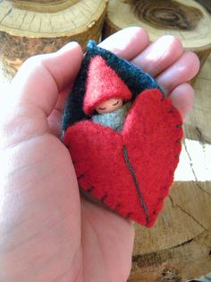 Waldorf Leaf Baby, Red & Green, Christmas Toy, Waldorf Gnome Playset, Leaf/ Heart Sleeping Bag, Upcycled eco toy. $15.00, via Etsy.