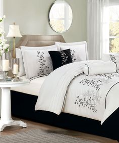 Garry might like the black & white color scheme better than our lavender sheets...def need to consider....