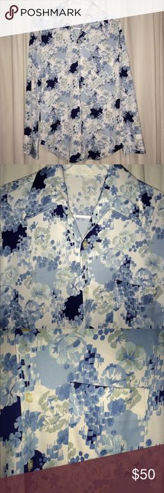"""Vintages men's long sleeve button down Vintage men's long sleeve button up shirt w/collar. 20"""" armpit to armpit flat. Square buttons and very pointy collar ends. Baby blue, dark blue, and white floral flower print. Charisma by Townline. 29"""" down neck to bottom. No size printed, but I would say men's medium. Great condition, no flaws. #rare #unique Shirts Dress Shirts"""