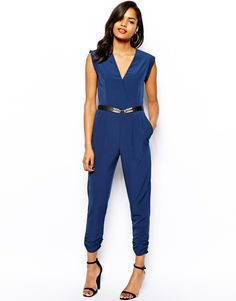 Jumpsuit by River IslandMade from a breathable woven fabricDeep V-necklineWrap frontBelt under the bustSide pocketsZip backRegular fitABOUT RIVER ISLANDRiver Island brings us an eclectic collection of fashion forward styles. Look out for vibrantly printed party dresses, feminine detailing, statement jackets and a covetable range of denim including skinny cut jeans and cute denim shorts, which sits alongside their directional footwear and swimwear range.