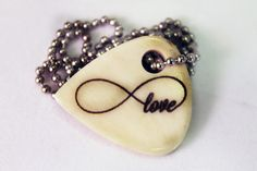 Infinity Love Bone Pick Necklace $10 http://www.sixshootergiftshop.com/collections/natural-guitar-pick-necklaces/products/infinity-love-bone-necklace