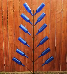 flat bottle tree - would be cute with lights and dif shades of green bottles for Christmas