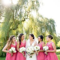 I just love the coral bridesmaids dresses with the elegant white bouquets. Just lovely!