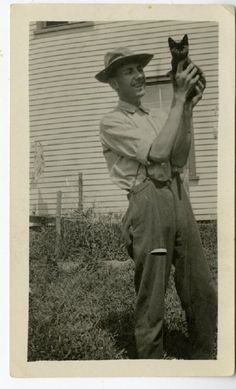 """A nice picture of a man and his pet. """"Merrill Joyce showing off his cat."""" (Swan's Island Historical Society)"""