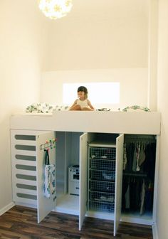 This is a great solution for small bedrooms.  Storage as well as a fun getaway space for small children to play.  Great idea!  A security railing could be added if falling out was a concern!