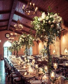 Rustic and luxe - long wooden tables set with tall centerpieces and lots of candles