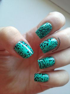 Love the color teal with black spots and stripes! #nailart #nails #polish - See more nail looks at bellashoot.com  share yours!
