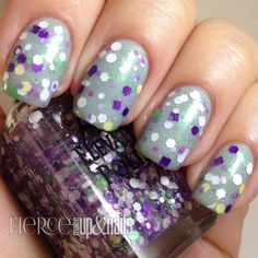 Passion Flower: A clear base glitter topper with multiple sized and shaped glitters. From white, purple, green, lavender, pink and yellow.