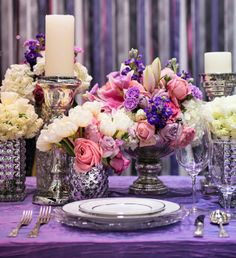 Replace it with white vases and a midnight blue table cover. Midnight blue would be too dark, but white would be perfect.