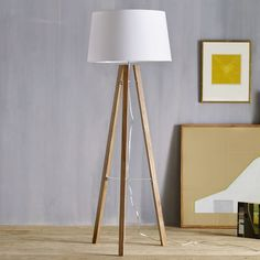 """Family Room   Tripod Wood Floor Lamp / Color: Solid Ash Legs in Natural Finish, Cotton Blend Shade / 20"""" diameter x 62.5"""" h"""