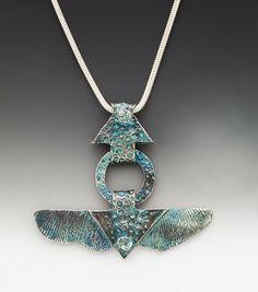 kinetic necklace, silver pendant, ginkgo leaf, Celtic relic, blue jeans…