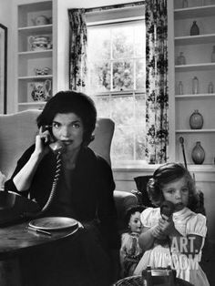Jackie Kennedy, wife of Senator John Kennedy, talking on the telephone as her young daughter Caroline mimics her by talking on a toy phone, at home. (Alfred Eisenstaedt—The LIFE Picture Collection/Getty Images) Caroline Kennedy, Jacqueline Kennedy Onassis, Jackie Kennedy, Kennedy Wife, Jaqueline Kennedy, Les Kennedy, Carolyn Bessette Kennedy, Jackie Jackie, Sweet Caroline
