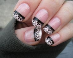Lace nails. but in turquoise and only on the ring finger??