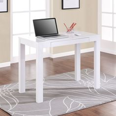 This white writing desk from Altra Parsons is ideal for using your laptop, writing, studying, or handcrafting. The white finish and clean lines give this desk a light modern look, and the handy drawer will help you to keep it free from clutter.