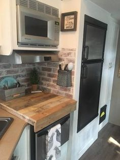 Faux brick backsplash in RV kitchen by Jennifer Reid