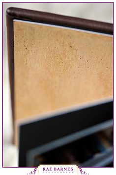 Leather Craftsmen 3500 Series album showcasing Gold Cork Endpaper. (Source: http://raebarnes.com/products/brooke-marcs-wedding-album/)