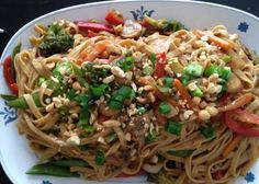 This is a recipe that Ive tweeked and adjusted to yield a warm noodle side-dish. It can also stand alone as a main dish. Its quick and easy and full of flavor! I serve it with Chicken Satay. Leftovers are yummy hot or cold.