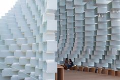 """BIG founder Bjarke Ingels has unveiled his Serpentine Gallery Pavilion – a wall of transparent bricks that has been """"unzipped"""" to create a curving interior"""