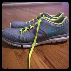 d11f5c2cb Shop Women s Nike Gray size 7 Athletic Shoes at a discounted price at  Poshmark. Description  Grey with aqua Nike swoosh