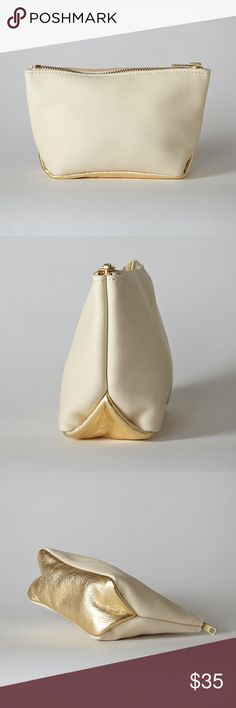 SALE Ivory and Gold Leather Pouch This perfect little pouch is made with the softest leather. Use it as a clutch, a makeup case, or to organize items in your larger bag. The golden bottom panel adds a stylish flair and dresses up this cute pouch.Measures7.5″ W x 4″ H x 2.5″D. Brass zipper. This pouch is from an online company I run which no longer sells leather products. The pouch is handmade in the U.S. and brand new. These were selling at $54 Bags Cosmetic Bags & Cases