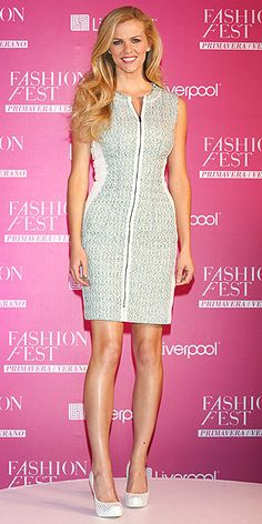 BROOKLYN DECKER The Sports Illustrated Swimsuit Issue model puts her outfit in neutral, showcasing her toned figure in a tailored zip-front dress and color-coordinated heels at an event in Mexico City.