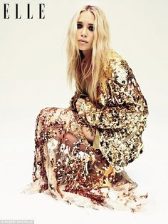 Loving Mary-Kate in this gold sequin jacket and sequined silk-tulle dress. Sequins are a girls best friend!