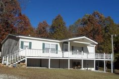 The property is located about 3/4 of a mile off a blacktop county road and has county road frontage on 2 sides. This manufactured home has covered front & back porches to enjoy all the Ozarks has to offer. There are 3 bedrooms and 2 baths. The large master suite has a walk-in closet and the master bath has a walk-in shower and garden tub. The country kitchen is well equipped with an eat-in bar and separate dining area and very open to the living room in Evening Shade AR