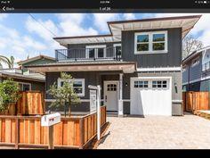 Dark grey craftsman exterior. Beach house.