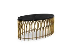 Mecca is a modern oval coffee table with a marble nero marquina table top and a geometric base made with brushed aged brass.