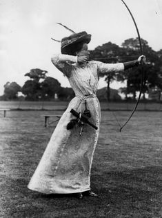 Miss Hepburn drawing her bow during the Ladies Day meeting of the Mid-Surrey Bowmen at Surbiton, 1910.
