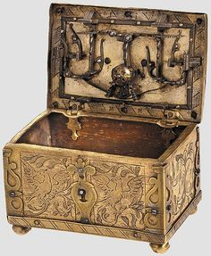 KUNSTHANDWERK,  Casket by Michel Mann Nuremberg c.1600, Rectangular miniature case of fire-gilt brass on ball feet. Riveted partly openwork edge reinforcements, false keyhole at the front. Lid with covered keyhole and elaborate locking system. 4.5 X 7.5 X 5cm.