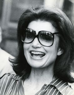 Jacqueline Kennedy Onassis. The first to want gradient sunglasses made