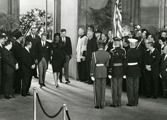 John F. Kennedy Lying in State November 25, 1963 -Jacqueline Kennedy and her brothers-in-law, Attorney General Robert Kennedy and Massachusetts Democratic Senator Ted Kennedy enter the Capitol Rotunda. Photo by Architect of the Capitol photographers.