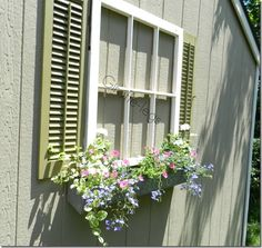 Add a cute window frame and planter box to the side of a shed or garage to make it much cuter!