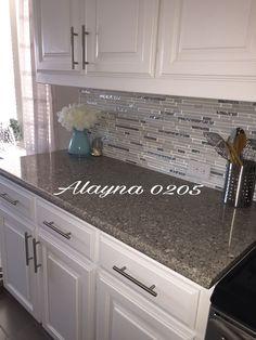 Alpina white quartz countertop. MS Cristallo interlocking glass and marble mosaic back splash. White cabinets. #homeimprovementkitchencountertops