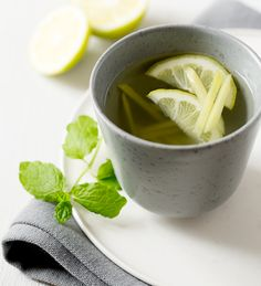 Enjoy a homemade tea of lemon and ginger from a pretty cup.