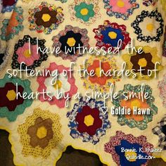 Our smiles can change everything! Turn yours on today!  Vintage grandmother's flower garden quilt found in Kentucky.  #quilt #quilting #patchwork #quiltville #bonniekhunter #vintagequilt #antiquequilt #hexies #epp #englishpaperpiecing #paperpiecingeverywhere   #deepthoughts #wisewords #wordsofwisdom #quiltvillequote
