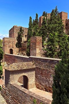 Castles of Spain - Alcazaba de  Málaga. Spain The Alcazaba is a Moorish fortification in Málaga, Spain. It was built in the mid-11th century. This is the best-preserved alcazaba (from the Arabic al-qasbah) in Spain. Adjacent to the entrance of the Alcazaba are ruins of a Roman theatre dating to the 2nd century BC,