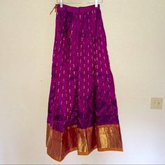 """Unique purple and gold maxi skirt Worn once, perfect condition. Absolutely stunning maxi skirt, measurements: approx. 24"""" waist (does not stretch), 40"""" long. Thank you for visiting my closet, please let me know if you have any questions. I offer great discounts on bundles  Dresses Maxi"""