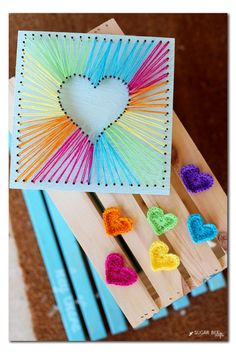 DIY rainbow string art tutorial by Michaels Makers Sugarbee Crafts --- How to do string art with pretty colors!