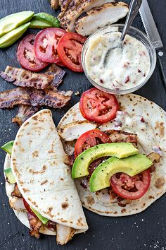 Sandwiches don't always have to mean two slices of bread - why not try this recipe for smokey chicken flatbread with crispy bacon, avocado and sundried tomato mayonnaise #BritishSandwichWeek