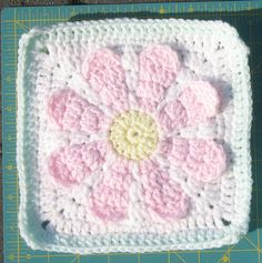 I love the way this flower comes out of the granny square.    Charity Daisy Crochet Pattern by Tiadelu, via Flickr