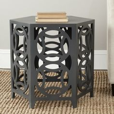 @Overstock.com - Whats good is good. Embrace circular logic with the Natanya side table. This chic accent piece adds contemporary charm with interlocking circles and the clean lines of its hexagonal tabletop. Perfect for classic interiors that need a punch.http://www.overstock.com/Home-Garden/Safavieh-Natanya-Charcoal-Grey-Side-Table/7827756/product.html?CID=214117 $179.99
